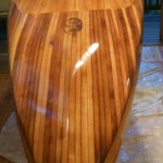 Cedar strip nose on wooden SUP.