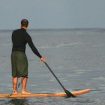 Looking for aquatic life on the Mighty Quinn wooden SUP.