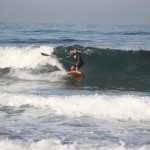 Wooden SUP paddle surfing.