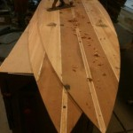 Wooden SUP decks being hand planed.