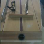 Marking centerline on wooden SUP.