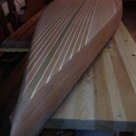 Bottom view of wooden SUP sanded and ready for epoxy coats.