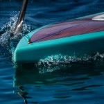 Wooden SUP waterline and bow wake.